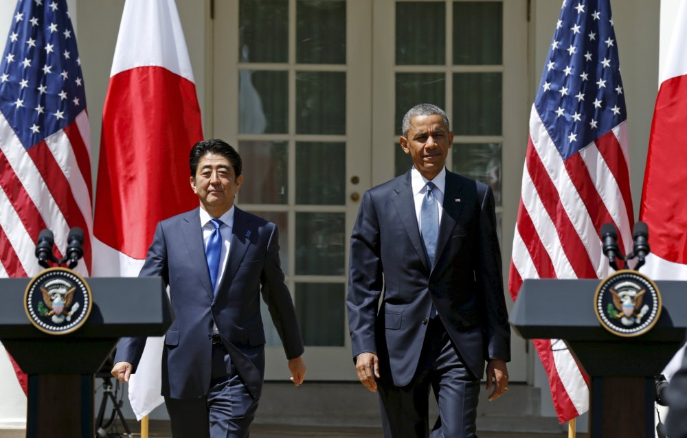 U.S. President Barack Obama and Japanese Prime Minister Shinzo Abe arrive for a joint news conference in the Rose Garden of the White House in Washington