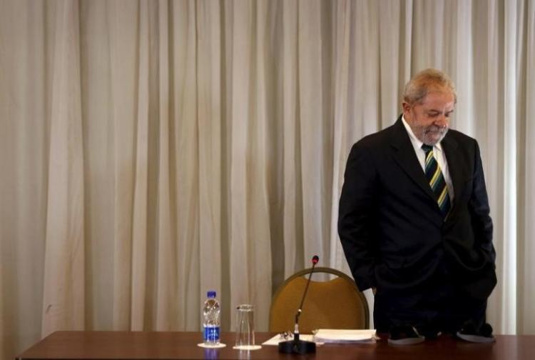 Former Brazilian President Lula da Silva arrives to a news conference with international media in Sao Paulo
